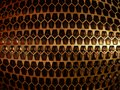 Abstract metal grille of the pentagons. Royalty Free Stock Photo