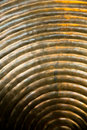 Abstract metal texture with curved lines and metallic smooth background in color Royalty Free Stock Photography