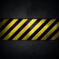 Abstract metallic background with yellow and black warning strip Royalty Free Stock Photo