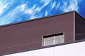 Abstract modern building detail and cloudy sky Royalty Free Stock Photo