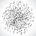 Abstract musical dot with black notes on white background.