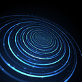 Abstract neon glowing circles on dark background.