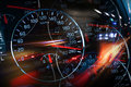 Abstract night racing illustration with blurred lights and speedometers Royalty Free Stock Photos