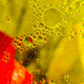 Abstract oil droplets on a water surface Royalty Free Stock Image