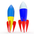 Abstract opposition two rockets with ukrainian and the russian flag Royalty Free Stock Photos