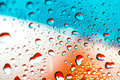 Abstract orange background with water drops Royalty Free Stock Photo