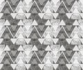 Abstract ornament from gray triangles and spirals