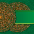 Abstract ornament mandala design invitations, cards, labels. Round logo and label template. Orange-green. Vector image