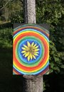 Abstract painting on canvas in the summer park. Yellow rudbeckia flower and rainbow circles. Royalty Free Stock Photo