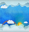 Abstract paper cut with sun, sunshine,white cloud and rainbow on blue water color texture background