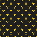 Abstract pattern. Yellow marks of radiation on a black background. Irradiation. Dangerous area. Vector illustration in a flat styl