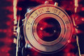 Abstract photo of old camera lens with glitter overlay. image is retro filtered. selective focus Royalty Free Stock Photo