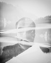 Abstract portrait spooky double exposure man in the black lake Royalty Free Stock Images