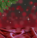 Abstract red and black bokeh christmas background with satin and pine branch Royalty Free Stock Photo