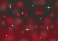 Abstract red and black bokeh Christmas background with twinkling stars