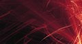 Abstract red, orange, gold light glows, beams, shapes on dark background
