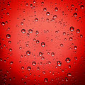 Abstract red water drop background droplets on Stock Photos