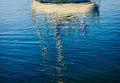 Abstract reflections of boats in the harbor water Royalty Free Stock Photo