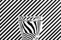 Abstract refraction of black and white diagonals in a glass of w Royalty Free Stock Photo