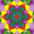Abstract rosette kaleidoscope in brilliant green, blue, neon, yellow, red  and magenta Royalty Free Stock Photo