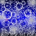 Abstract round blue and black bokeh,blue and black bubble background,Water drops on abstract background, texture with disks. Royalty Free Stock Photo