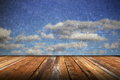 Abstract scratched backdrop with wood terrace and grungy beautiful blue sky Stock Photo