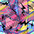 Abstract seamless chaotic pattern with urban geometric elements triangles. Grunge neon texture background. Royalty Free Stock Photo