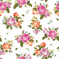Abstract seamless floral pattern with pink and orange roses on w Royalty Free Stock Photo