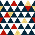 Abstract seamless pattern with triangles in red, gold and dark blue.