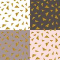 Abstract seamless repeating pattern with gold glitter triangles on different backgrounds