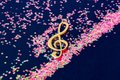 Abstract shiny musical note on blue background. Royalty Free Stock Photo