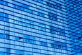 Abstract shot of glass transparent skyscraper office building for texture or background. Blue toned. Royalty Free Stock Photo