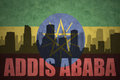 Abstract silhouette of the city with text Addis Ababa at the vintage ethiopian flag Royalty Free Stock Photo