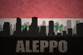 Abstract silhouette of the city with text Aleppo at the vintage syrian flag