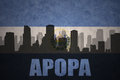 Abstract silhouette of the city with text Apopa at the vintage salvadoran flag