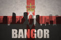 Abstract silhouette of the city with text Bangor at the vintage northern ireland flag