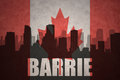 Abstract silhouette of the city with text Barrie at the vintage canadian flag