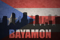 Abstract silhouette of the city with text Bayamon at the vintage puerto rican flag
