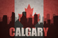 Abstract silhouette of the city with text Calgary at the vintage canadian flag Royalty Free Stock Photo