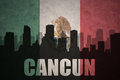 Abstract silhouette of the city with text Cancun at the vintage mexican flag