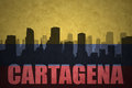 Abstract silhouette of the city with text Cartagena at the vintage colombian flag