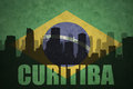 Abstract silhouette of the city with text Curitiba at the vintage brazilian flag