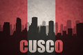 Abstract silhouette of the city with text Cusco at the vintage peruvian flag