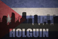 Abstract silhouette of the city with text Holguin at the vintage cuban flag