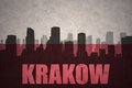 Abstract silhouette of the city with text Krakow at the vintage polish flag