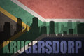 Abstract silhouette of the city with text Krugersdorp at the vintage south africa flag Royalty Free Stock Photo