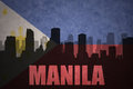 Abstract silhouette of the city with text manila at the vintage philippines flag