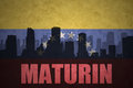 Abstract silhouette of the city with text Maturin at the vintage venezuelan flag