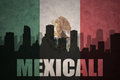 Abstract silhouette of the city with text Mexicali at the vintage mexican flag
