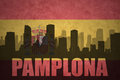 Abstract silhouette of the city with text Pamplona at the vintage spanish flag Royalty Free Stock Photo